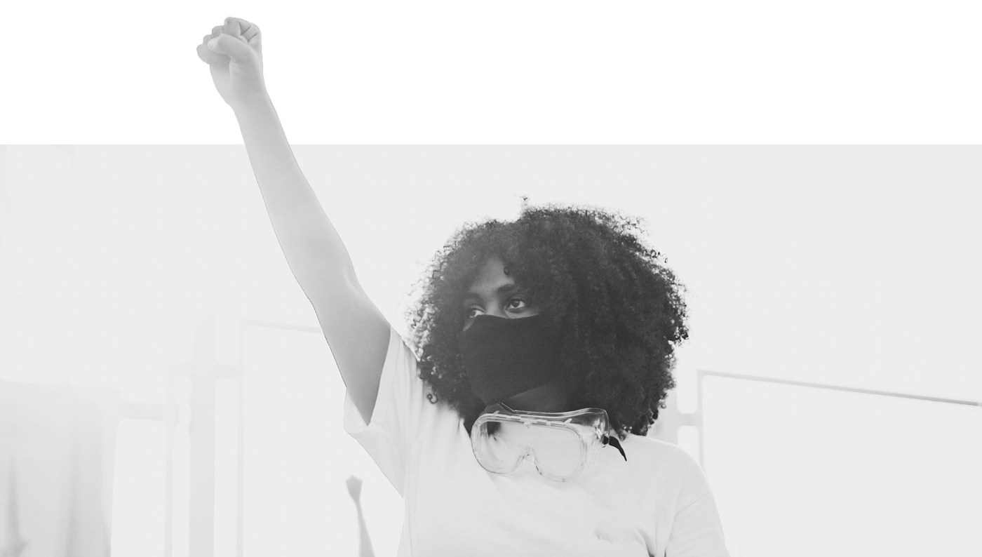 Woman of color with raised fist